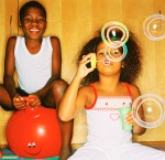 Young Girl (8-10) Blowing Bubbles and Young Boy (10-14) on Inflatable Bouncing Ball